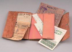 Portefeuille comprenant différents types de tickets de rationnement © Coll. Musées départ. Ain
